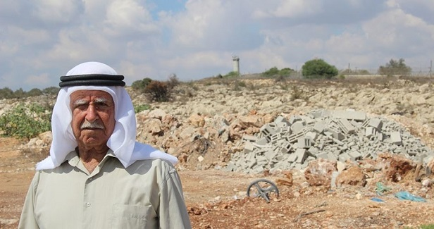Haunted by his love for a land robbed by the separation wall