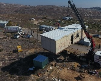 Israeli settlers dismantle own structures illegally set up on Palestinian lands