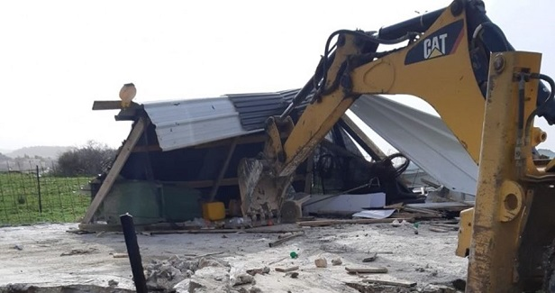 Israel forces Palestinian to demolish his store