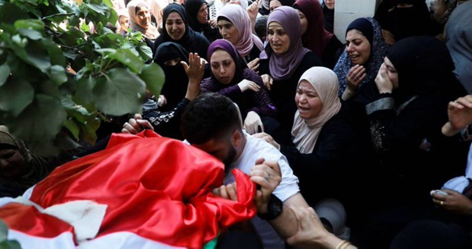 Palestinians bid farewell to mother killed in IOF raid