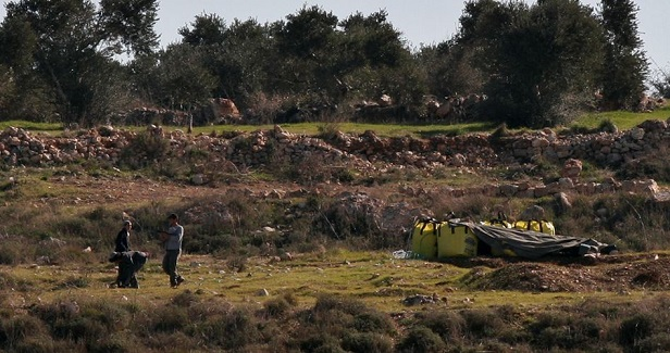 Israeli settlers force Palestinian man out of his own land