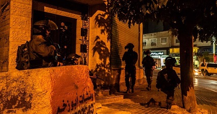 IOF injures woman, arrests three men in West Bank raids