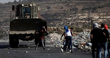 IOF razes Palestinian land, clashes with citizens in Qalqilya