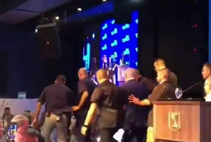 Watch: Netanyahu Abandons Stage following Sirens, Alleged Rockets