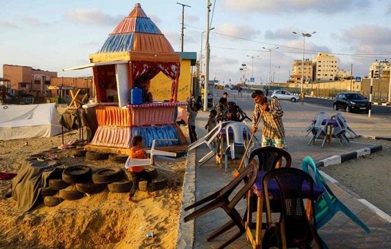 In Gaza, unpaid government salaries dampen Eid joy