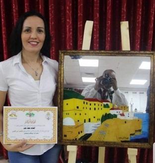 الفنانة أبو عابد: لوحاتي تُعبِّر عن معاناة الحرب والجوع