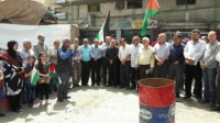 وقفة للاجئين بغزة رفضاً لتقليص الدعم المالي لـلأونروا