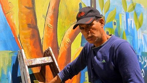 الفنان التشكيلي محمد الشلبي يعكس هموم اللاجئ الفلسطيني على جدران مخيم جنين
