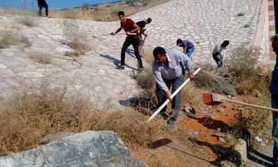 حملـة نظافـة وتشجيـر في مخيم الرمدان