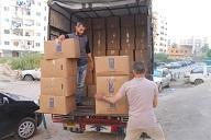 توزيع طرود نظافة على فلسطينيي سورية في مخيم البداوي شمال لبنان