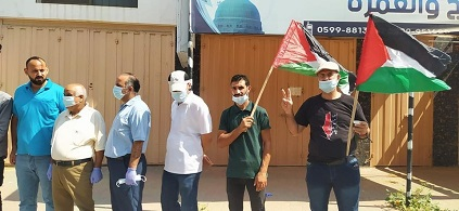 اللجنة الشعبية للاجئين بمُخيّم المغازي تنظم وقفة احتجاجية رفضاً للتطبيع